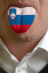 man tongue painted in slovenia flag symbolizing to knowledge to