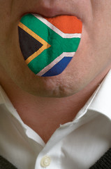 man tongue painted in south africa flag symbolizing to knowledge