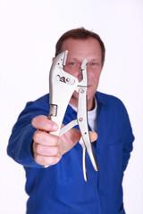 Man holding mole-grips