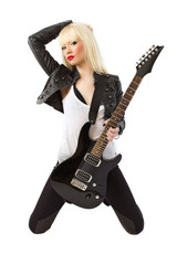 Sexy beautiful blonde woman posing with black electric guitar