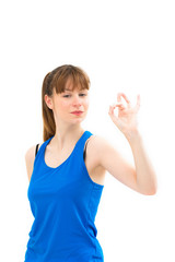 Young woman showing OK hand sign