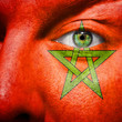 Flag painted on face with green eye to show morocco support