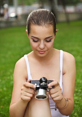 Beautiful smiling young girl with camera