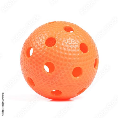 orange floorball ball isolated on white background