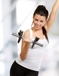 portrait of young woman doing fitness with weights indoor