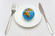 Consumerism concept - the Earth on a plate