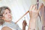 Closeup portrait of a beautiful artist, painter. poster