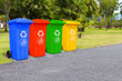 Four color trash cans in the park