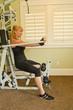 Caucasian woman using exercise machine