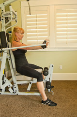 Caucasian woman using exercise machine