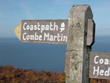 Signpost on coastal path over Trentishoe Down
