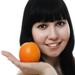 Portrait of a beautiful woman, holding an orange