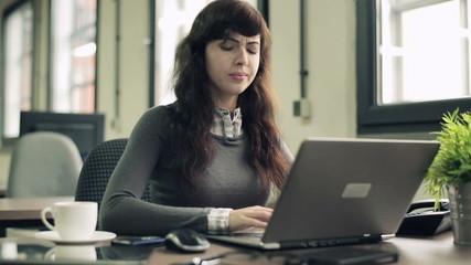 Young attractive businesswoman having headache