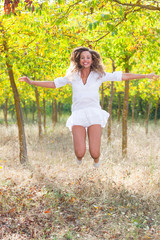 Beautiful Young Woman Jumping Outdoor