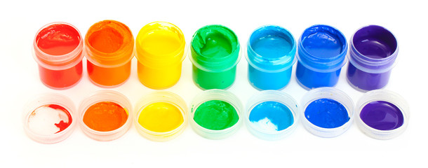 jars with multicolored gouache isolated on white background