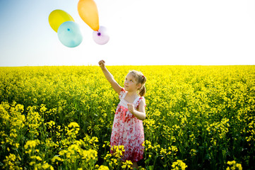Balloons on a yellow field