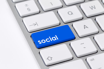 Keyboard with single blue button showing the word social