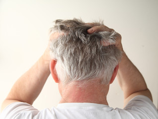 rear view of a man showing negative feelings