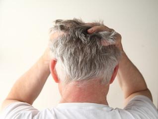 rear view of a man showing negative feelings