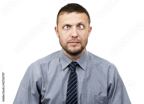 Funny bearded businessman makes funny eyes on white