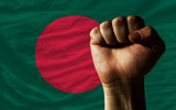 Hard fist in front of bangladesh flag symbolizing power