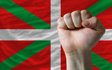 Hard fist in front of basque flag symbolizing power