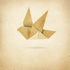 Origami Bird  Recycled Papercraft on paper background