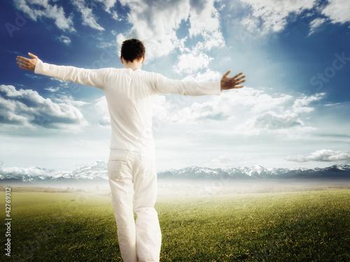 Enjoying pure freedom   Man on a meadow