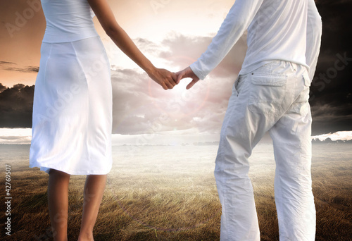 Enjoying pure freedom | Happy couple holding hands