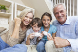Grandparents & Children Family Playing Video Console Games