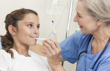 Nurse Taking Temperature of Young Girl Child Patient