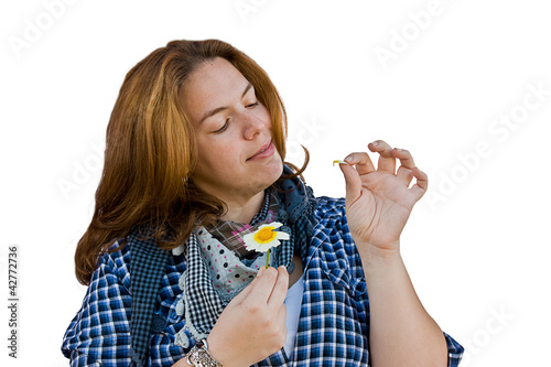 woman detaching petals on a flower