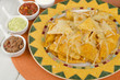 Cheesy Nachos with refried beans, guacamole, salsa & sour cream