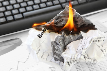 Burning Rejected Business Plan on the Office Background