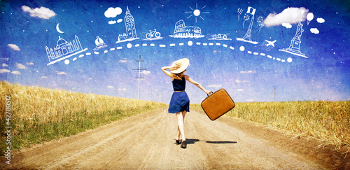 Lonely girl with suitcase at country road dreaming about travel. - 42780517