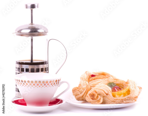Coffee cup and fruit cake on a white background