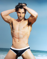 Sexy male model in fashion swimwear posing