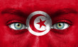 Human face painted with flag of Tunisia