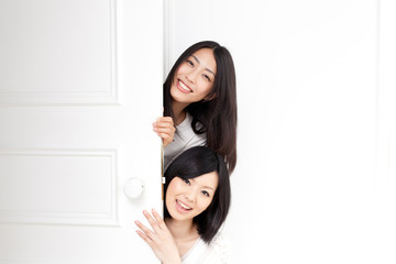 a young asian women with door