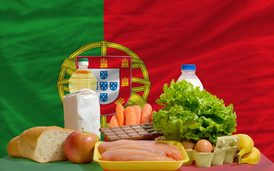 basic food groceries in front of portugal national flag