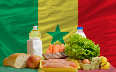 basic food groceries in front of senegal national flag