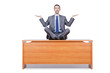 Man meditating on the desk