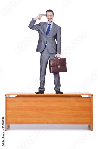 Businessman with gun on white