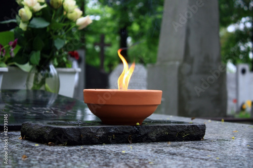 candle burning on cemetery - 42793145