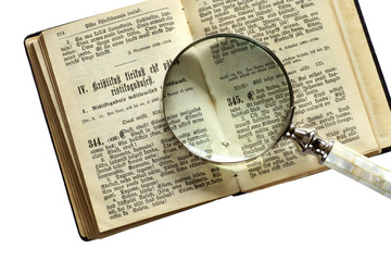 bible book with hand lens