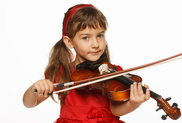 Girl playing the violin over white background