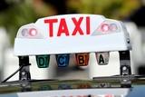 Fototapety ' Lumineux ' de taxi en service ' occupé '