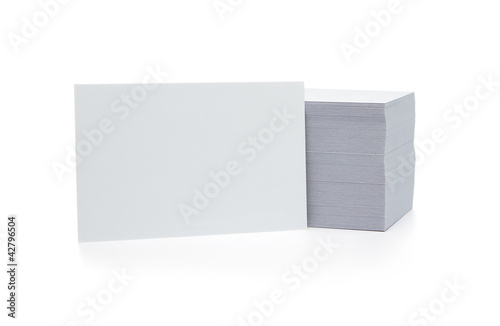 Stack of blank business cards isolated on white background with