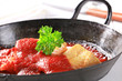 Pan fried fish fillets with tomato sauce