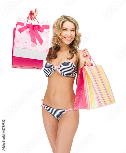 seductive woman in bikini with shopping bags